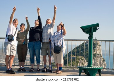Portrait of happy excited tourists people on the Rock of Gibraltar.