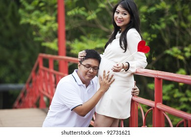 Portrait of happy expecting couple in the nature