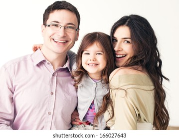 Portrait of a happy family against a back background.
