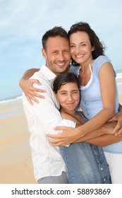 Portrait of happy family at the beach