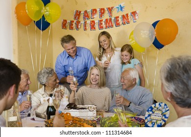 Portrait of happy family celebrating retirement party