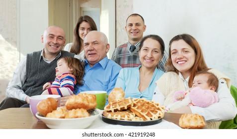 Portrait of happy family communicate around tea table
