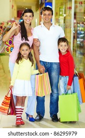 Portrait of happy family during shopping