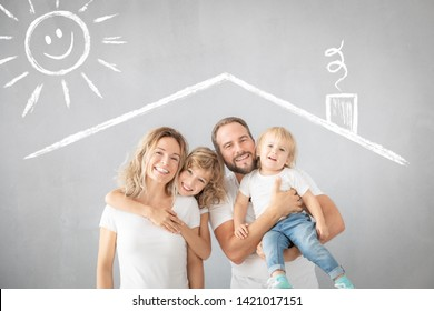 Portrait of happy family - father, mother, daughter and son - against grey background. Parents with children having fun at home.