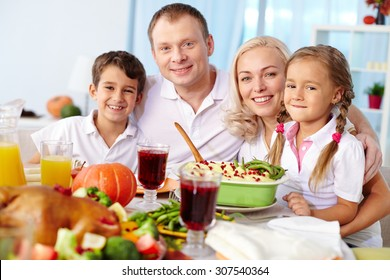 Portrait of happy family at festive table