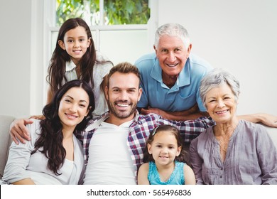 Portrait of happy family with grandparents at home
