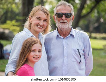Portrait of happy family with grandparents at park