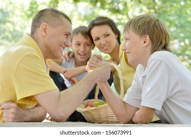 Portrait of a happy family having fun at outdoor table