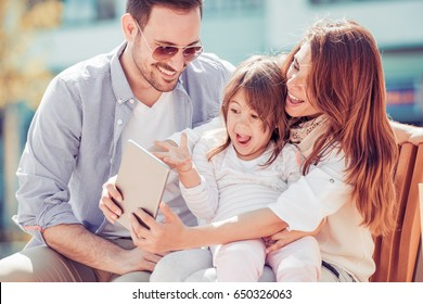 Portrait of happy family having fun together,taking selfie.
