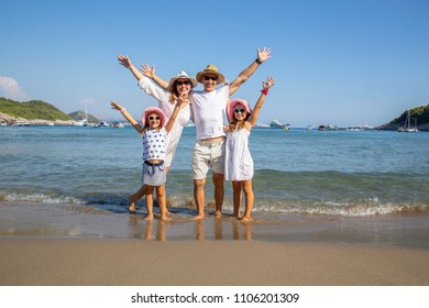 portrait of a happy family having a rest on the sandy beach of a sea resort