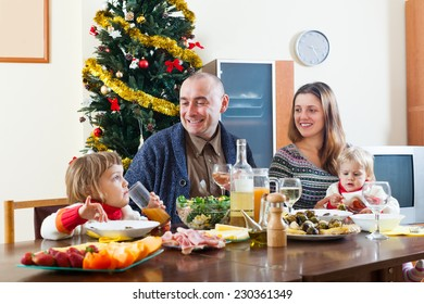 Portrait of Happy family with kids celebrating Christmas over holiday table at home