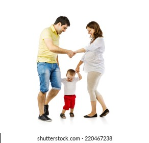 Portrait of the happy family with little boy and pregnant mother playing, isolated on white background