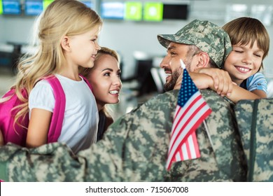 portrait of happy family and man in military uniform at airport