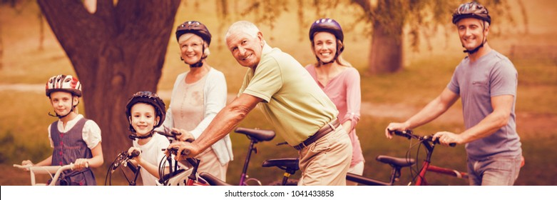 Portrait of happy family on bike at park