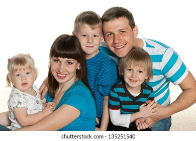 Portrait of a happy family on the white background