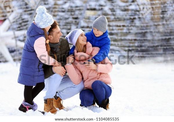 Portrait of happy family outdoors on winter day