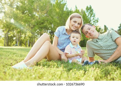 Portrait of a happy family in the park.