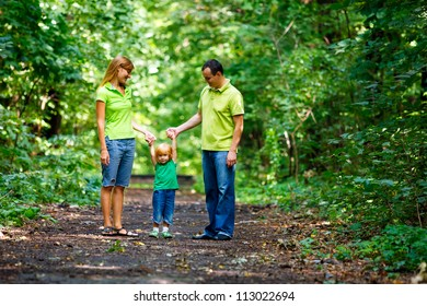Portrait of Happy Family In Park - outdoor shot