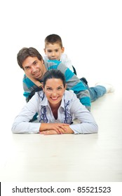 Portrait of happy family piled up in their house on floor