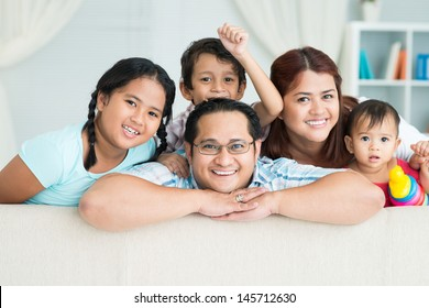 Portrait of a happy family posing at camera together