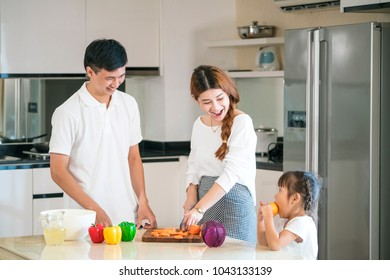 portrait of Happy family preparing vegetables together in the kitchen