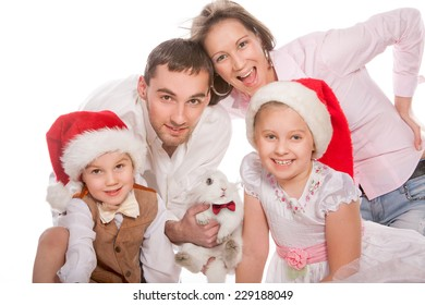 Portrait of happy family with rabbit on white background