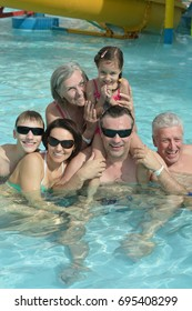 Portrait of a happy family relaxing in the pool