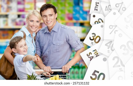 Portrait of happy family in the shop. Concept of savings