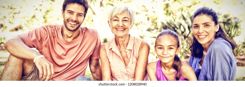 Portrait of happy family sitting in the park