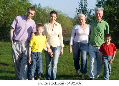 portrait of a happy family of six on the nature
