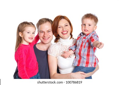 Portrait of happy family smiling at the camera. Isolated over white.