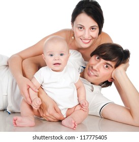 Portrait of a happy family smiling on a white background