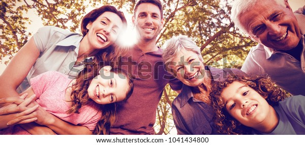 Portrait of happy family smiling at park