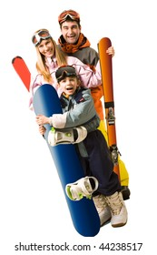 Portrait of happy family with snowboards looking at camera on white background