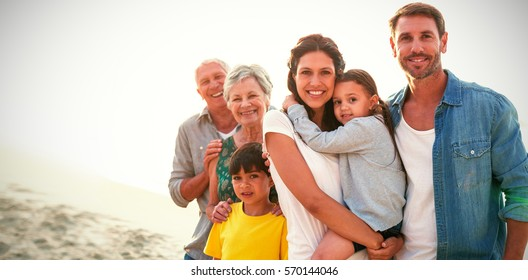 Portrait of happy family standing at beach