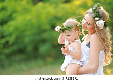 portrait of a happy family in the summer on the nature