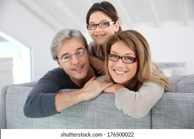 Portrait of happy family wearing eyeglasses