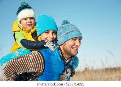 portrait of a happy family in the winter. parents and child outdoors