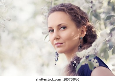 Portrait of happy fashion beautiful woman on nature