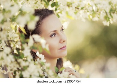 Portrait of happy fashion woman on nature