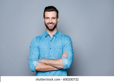 Portrait of happy fashionable handsome man in jeans shirt  crossing hands and look at camera