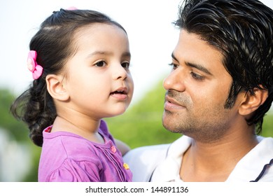 portrait of happy father and and daughter in the outdoors