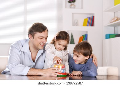 Portrait of happy  father and his children playing at home