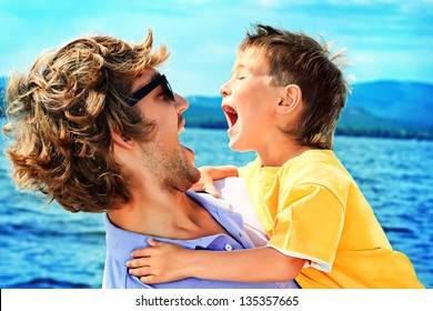 Portrait of a happy father with his little son on vacation.