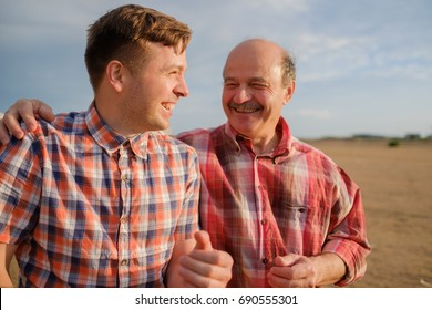 portrait of happy father and son walking outdoors. They look on each other