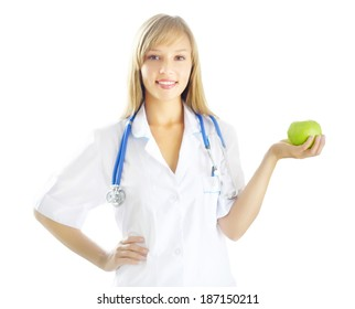 Portrait of a happy female doctor with green apple isolated on white background