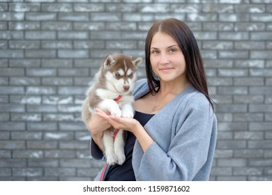 Portrait of happy female strolling with her pet at leisure with copy space