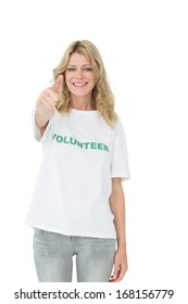 Portrait of a happy female volunteer gesturing thumbs up over white background