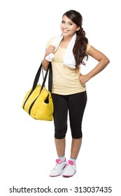 09fc3a7d A portrait of a happy fit young woman with gym bag standing ready for  fitness exercise