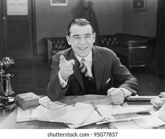 Portrait of happy friendly businessman